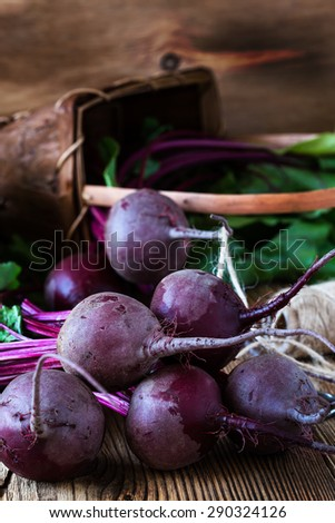 Bunch of fresh organic beetroots on wooden rustic table - stock photo