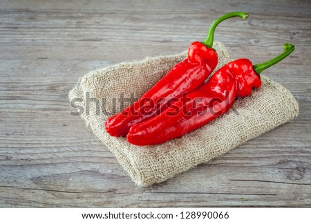 Bunch of fresh red pepper on wooden background