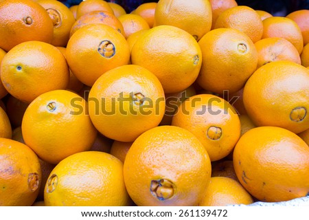 Bunch of fresh tangerines oranges on market - stock photo