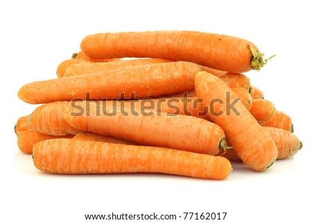 bunch of fresh winter carrots on a white background - stock photo