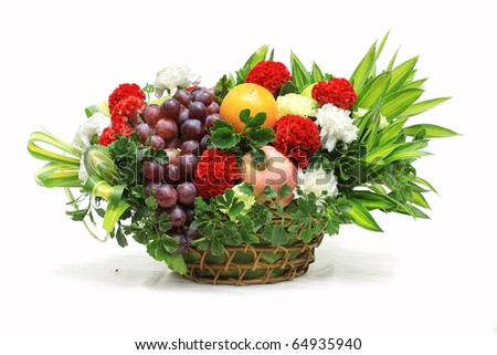 Bunch of fruits and flowers in a basket - stock photo