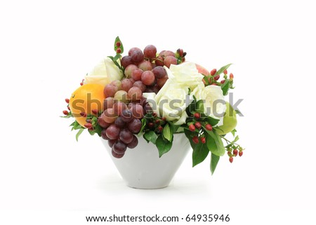 bunch of fruits and flowers in a vase - stock photo