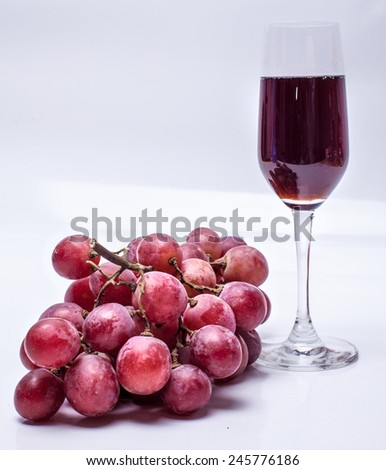 bunch of grapes and a wine glass