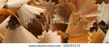 Bunch of graphite pencil shavings, close up, macro  - banner / header edition - stock photo