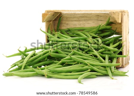 bunch of green beans in a wooden box on a white background - stock photo