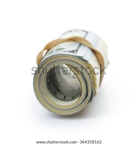 bunch of hundred dollar bills tied with rubber band - stock photo