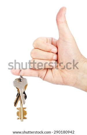 Bunch of keys in hand on white background - stock photo