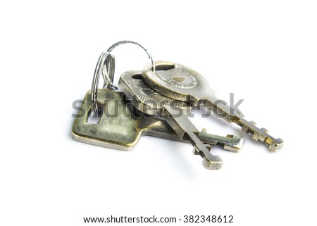 Bunch of keys isolated on white - stock photo