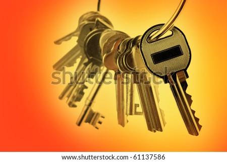 Bunch of keys on orange tone background - stock photo