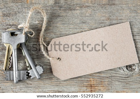 Bunch of keys with blank tag on the wooden background