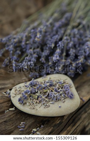 Bunch of lavender flowers - natural spa background with wood - stock photo