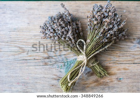 Bunch of lavender flowers on an old rustic wooden table