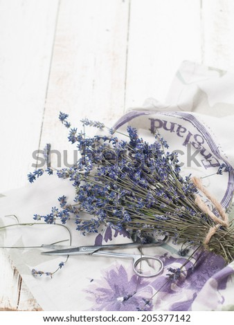 Bunch of lavender flowers on table, selective focus - stock photo