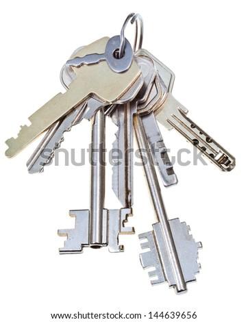 bunch of metal door keys isolated on white background - stock photo