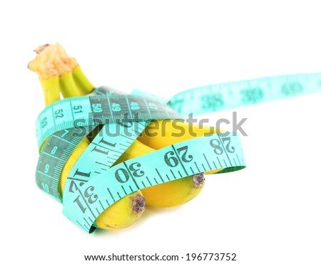 Bunch of mini bananas and measuring tape, isolated on white