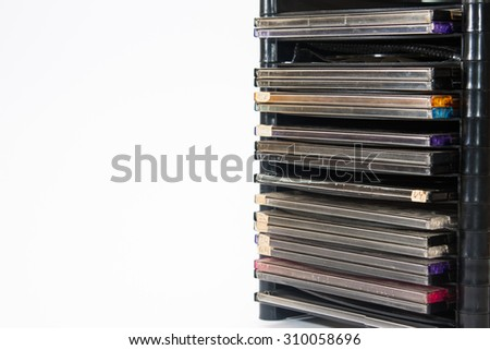 Bunch of old compact discs in plastic shelf. - stock photo