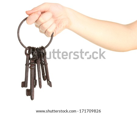 Bunch of old keys in hand isolated on white - stock photo