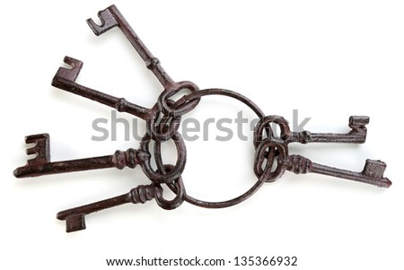 Bunch of old keys isolated on white