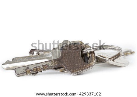 Bunch of old keys isolated on white background