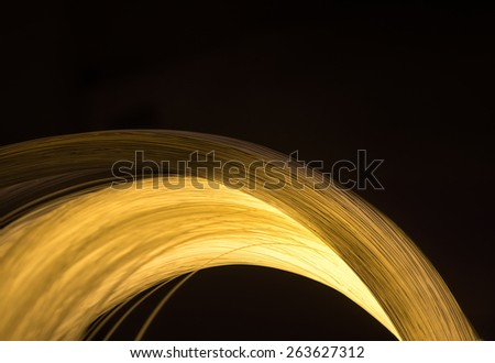 bunch of optical fibres dinamic flying from deep on technology background - stock photo