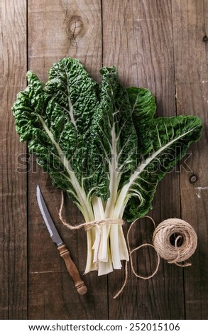 Bunch of organic silverbeet on a rustic wooden background. Selective focus, shallow dof - stock photo