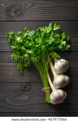 bunch of parsley on wooden background - stock photo