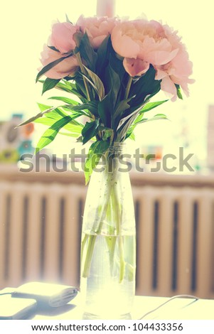 Bunch of peonies in vase, art - stock photo