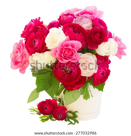 bunch of pink  ranunculus and rose flowers in pot  isolated on white background - stock photo