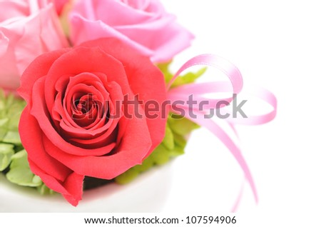 Bunch of pink roses and red isolated on white