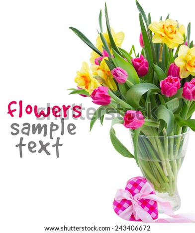 bunch  of pink tulip flowers and yellow daffodils in vase with pink gift box  isolated on white background - stock photo