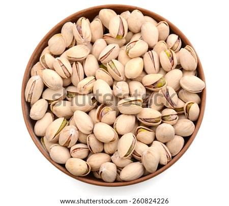 bunch of pistachio in bowl isolated on white  - stock photo