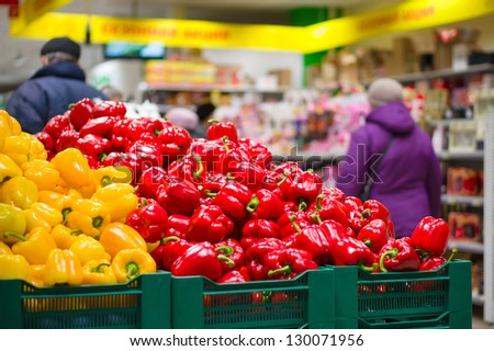 Bunch of red and yellow paprika peppers in supermarket - stock photo