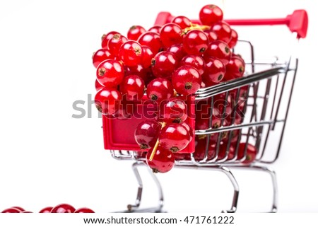 Bunch of red currants in a shopping cart on a white background. Healthy fruit with antioxidant.