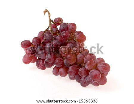 Bunch of red grape on white ground - stock photo