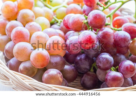 Bunch of red grapes in  basket