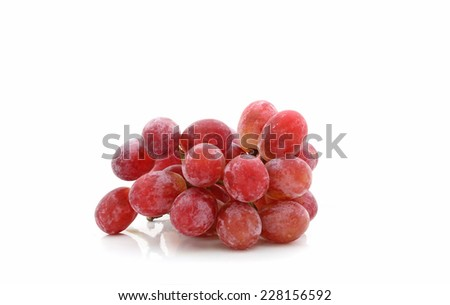 Bunch of red grapes isolated over white background - stock photo