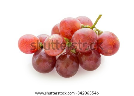 Bunch of red grapes on white background - stock photo