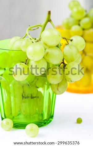 bunch of ripe and juicy green grapes close-up on a white background - stock photo