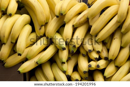 Bunch of ripe bananas arranged for sale on green market