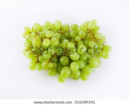 Bunch of ripe tasty green grapes. Top view. - stock photo
