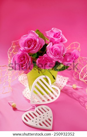 bunch of roses and white hearts on pink background - stock photo