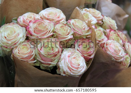 Bunch roses flowers wrapped brown paper stock photo royalty free bunch of roses flowers wrapped in brown paper florist bouquet pastel colors mightylinksfo
