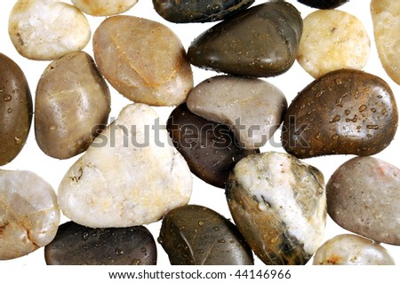 Bunch of  small wet zen stones with a white background - stock photo