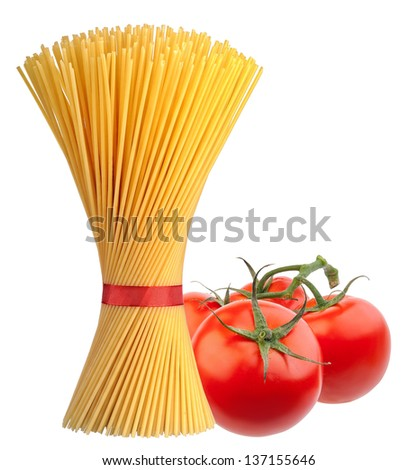 Bunch of spaghetti pasta with fresh tomatoes - stock photo