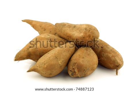 bunch of sweet potatoes on a white background - stock photo
