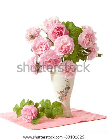 Bunch of tea roses in the vase isolated on white - stock photo