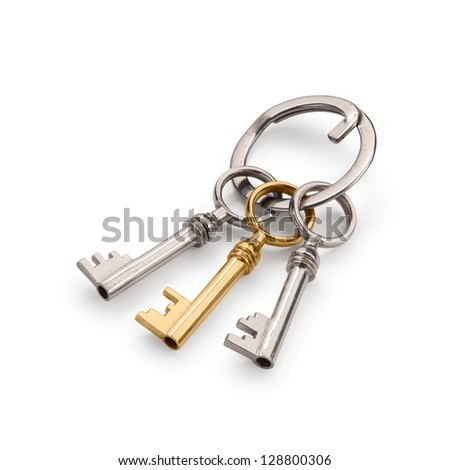 Bunch of three old keys, with a golden one. Isolated on white with clipping path and soft shadows. - stock photo