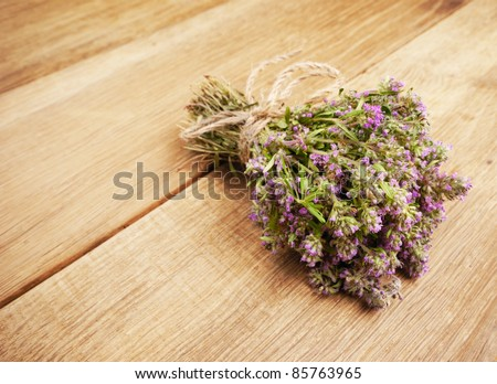 Bunch of thyme herb  on the oak table - stock photo