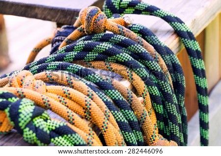 Bunch of used climbing ropes on a wooden bench - stock photo