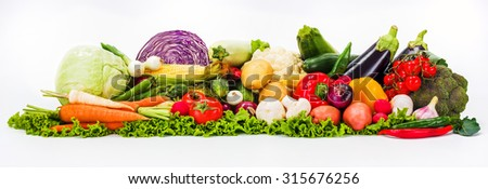 Bunch of various colorful summer vegetables on white